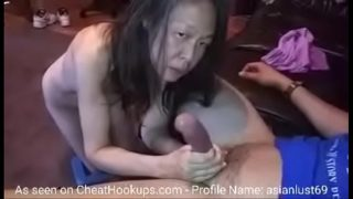 Mature Chinese Woman Sucks Long Cock Like a Pro