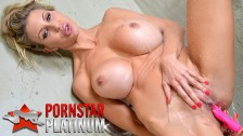 Big tit blonde bombshell Puma Swede masturbating in the shower with her toy
